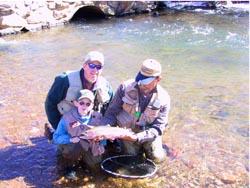 Family Enjoying Fly Fishing Trip